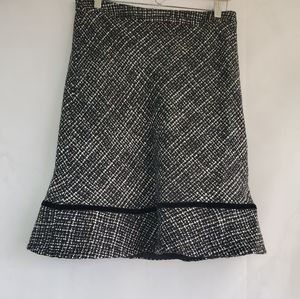 Gap Tweed 47% Acrylic and 30%Wool 15% Rayon.